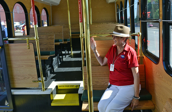 Globe/Roger Nomer<br /> Marsha Wallace waves aboard the new Joplin trolley before Thursday's ribbon cutting for the new bus at the Joplin Public Library.