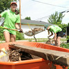From the left: World Renew volunteers Kaylee Sartell, 12, of Altoona, Iowa and Leah Bergman, 12, also of Altoona, help remove debris at a tornado damaged home near 18th and Military on Wednesday in Baxter Springs.<br /> Globe | Laurie Sisk