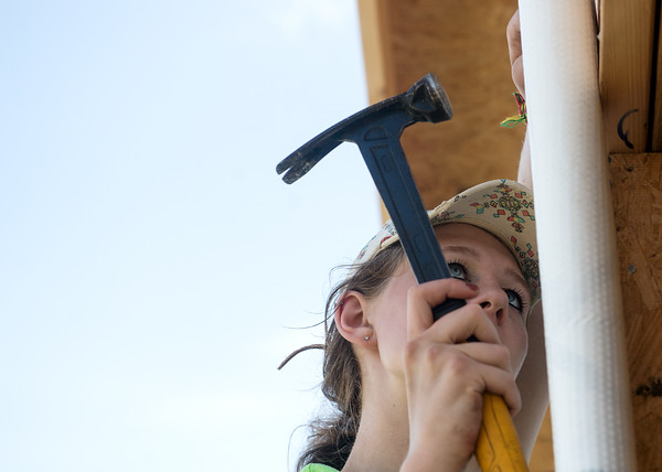 Globe/Roger Nomer<br /> Taylor Dum, 17, Grand Rapids, Mich., works on a house on Kentucky as she volunteers on Wednesday with World Renew Disaster Response Services.
