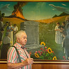 Globe/Roger Nomer<br /> Wayne Johnson talks about his grandfather Burk Johnson, who died in the 1914 Tipton Ford train wreck. Johnson is pictured in front of Anthony Benton Gude's mural of the wreck at Neosho United Methodist Church.