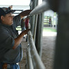 Globe/Roger Nomer<br /> Cody Jones, 13, Carthage, helps put together a fence at the Jasper County Fairground on Monday.