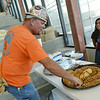 Globe/Roger Nomer<br /> Jeff Vollmer, with Weaver Steel, takes a cookie from incoming Joplin High senior Maricela Santillan at the construction site of the new Joplin High School in Joplin, Mo., on Friday, July 25, 2014. Students offered cookies and lemonaide to workers at the site as a thank you for their work in building the new school.