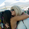 Globe/Roger Nomer<br /> Haven Shepherd receives a supportive hug from her mother Shelly before her race on Friday, July 15, at Schifferdecker Pool.