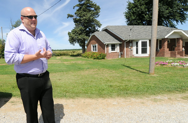 Jason Bolt, a spokesperson for opponents of a landfill in Riverton, stands by a house near a proposed landfill on Tuesday. Bolt Tuesday discussed a lack of communication between the City of Galena and county residents.<br /> Globe | Laurie Sisk