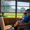 Globe/Roger Nomer<br /> Patrick and Nathan, 5, Walls relax on Thursday as they ride the street car through King Jack Park. The Walls family is originally from Webb City and were visiting from Kenya, where they live now.