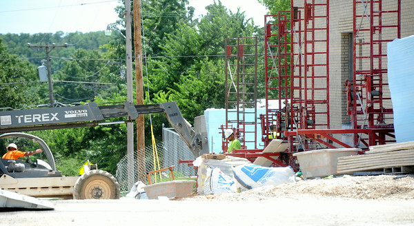 Crews continue working Monday on construction of a safe room at Royal Heights.<br /> Globe | Laurie Sisk