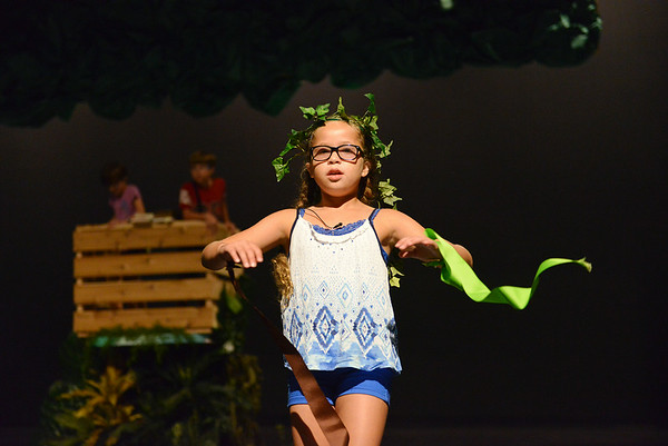 "Globe/Roger Nomer<br /> Alea Davis, 10, rehearses for a production of ""Dinosaurs After Dark"" during Thomas Jefferson Independent Day School's Summer Discovery Academy on Thursday. Campers in the Showtime class will present the final production on Saturday at 6:00 p.m., which will be open to the public."