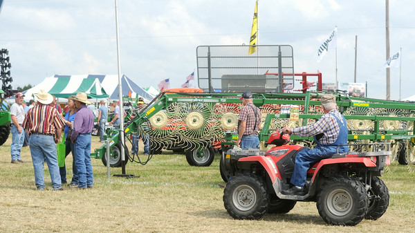 By foot and ATV, spectators roam the grounds of the Four State Farm Show on Friday in Pittsburg.<br /> Globe | Laurie Sisk