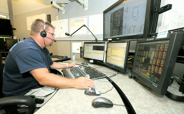 Dispatcher Mike Runnebaum fields calls on Thursday at the Jasper County 911 Center.<br /> Globe | Laurie Sisk