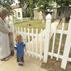 Janet Garvin and her grandson, Sam Myers,2, enter the front gate of the all-metal Lustron house that Garvin purchased and is not renting to a tennant.<br /> Globe | Laurie Sisk