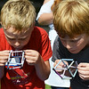 """Globe/Roger Nomer<br /> Brothers Jace, 8, and Tyler, 10, Haywood attempt to blow cube-shaped bubbles during the Art Feeds """"Fizz, Boom Workshop"""" at the Joplin Public Library on Friday."""