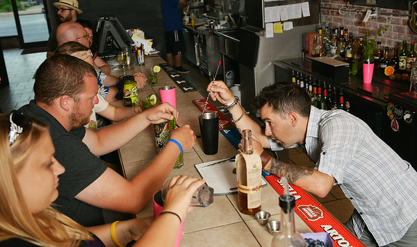 Globe/Roger Nomer<br /> Daniel Valentine helps customers prepare a variety of mint juleps at Palace Pizza on July 1, 2014.