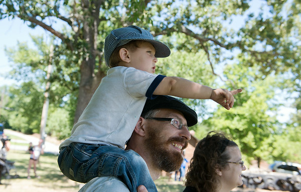 Globe/Roger Nomer<br /> Train fan Robbie Cornett, 2, points out the arrival of the train car to his father Philip at Redings Mill on Monday.