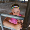 Globe/Roger Nomer<br /> Aubri Fisher, 10, Carthage, helps set up a fence at the Jasper County Fairground on Monday.