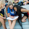 Globe/Roger Nomer<br /> (from left) Lindsay Adams, 10, Chloe Miller, 9, Sydnei Storm, 17, and Haven Shepherd look at lane assignments for upcoming races on Friday, July 15, at Schifferdecker Pool.