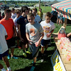 Globe/Roger Nomer<br /> Members of the Joplin High soccer team take a break on Thursday at a lemonade stand that benefits Joplin teacher Amanda Sharp.