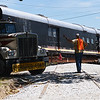 Globe/Roger Nomer<br /> Orrin Tilton directs the rail car onto its tracks in Redings Mill on Monday.
