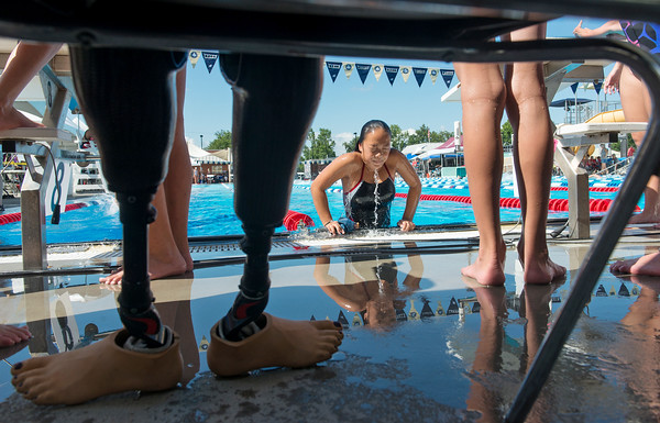Globe/Roger Nomer<br /> Haven Shepherd pulls herself out of Schifferdecker pool after warmups for a meet on Friday, July 15. After losing her legs as a child, Shepherd uses prosthetic legs to walk.