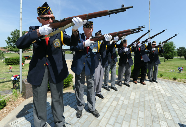 American Legion veterans practice a rifle salute  before a veteran's memorial service on Wednesday at Mount Hope Cemetery.<br /> Globe | Laurie Sisk