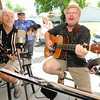 Corky Dow, left and J R Sampson entertain the crowd at  the Webb City Farmers Market on Friday. <br /> Globe | Laurie Sisk<br /> ### NOTE to eds: J R has no periods ..all caps and a space between J and R ###
