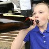 Eight-year-old Callie Sweet, od Diamond, enjoys a chug off a bottle of old-fashioned root beer on Thursday at the Newton County Fair.<br /> Globe | Laurie Sisk
