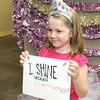 Seven-year-old Lillian Syring poses during a photo booth activity  during the Art Feeds Glow, Sparkle and Shine workshop on Saturday at St, Paul's United Methodist Church. Youth were taught the importance of not only sparkling on the outside, but also of glowing from within.<br /> Globe | Laurie Sisk