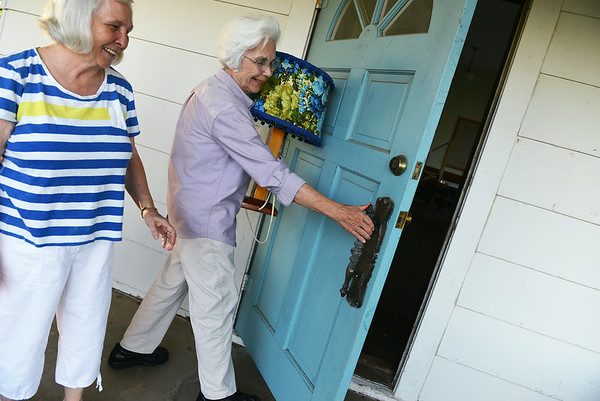 Globe/Roger Nomer<br /> Gayle Chapman, left, and Blanche Shelton close the door to the Kings Prairie School on Thursday.