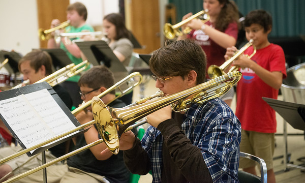 Globe/Roger Nomer<br /> Noah Larson, 15, Joplin, practices on Monday during the summer Jazz Camp at Missouri Southern.