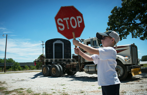 Globe/Roger Nomer<br /> Blanton Garrigan, 8, pitches in to helps with traffic control as the former Kansas City Southern mail car arrives in Redings Mill on Monday.