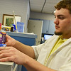 Globe/Roger Nomer<br /> Chris Reynolds, an intern at Lindburg Pharmacy in Pittsburg, stocks pseudoephedrine on Friday, June 27, 2014.
