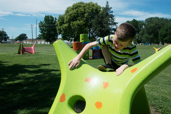 Globe/Roger Nomer<br /> Trenton Banks, 10, plays on Friday on equipment at Katy Park in Chanute.