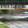Globe/Roger Nomer<br /> A car turns around on Murphy Boulevard to avoid flooding on Thursday morning.