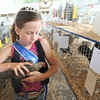 """Nine-year-old Brylee Sage holds her hen, """"Rocket"""" on Thursday at the Newton County Fair. Sage was named Junior Princess at this year's fair.<br /> Globe 