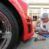 Manny Windham, of Bentonville, Ark. polishes the grill on his 2007 Stage 3 Roush Mustang during the Show and Shine portion of the Mustang Mother Road Weekend on Friday in downtown Joplin. <br /> Globe | Laurie Sisk
