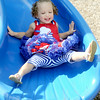 Twenty-month-old Cardin Cox enjoys a ride down a slide during the Independence Day celebration on Friday at Landreth Park.<br /> Globe | Laurie Sisk