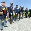 Veterans of the American Legion stand at parade rest before the start of a veteran's memorial service on Wednesday at Mount Hope Cemetery.<br /> Globe | Laurie Sisk