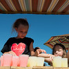 Globe/Roger Nomer<br /> Drew Yockey, 10, and Paizli Moore, 7, prepare for a crowd at a lemonade stand to benefit teacher Amanda Sharp on Thursday.