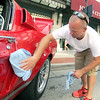 Gary Whittington, of Van Buren, Ark., polishes his 1968 Mustang Fastback downtown on Friday in preparation for the Mustang Mother Road Weekend.