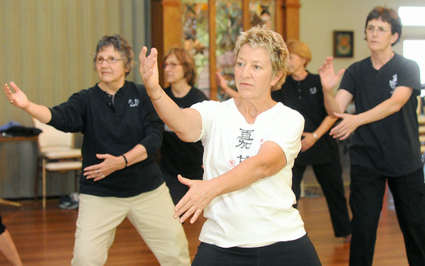 Becky Browne leads a Tai Chi class on Thursday at Unity Church. <br /> Globe | Laurie Sisk