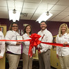 Globe/Roger Nomer<br /> Hillary and Adam Bokker cut the ribbon to recognize the fifth anniversary of their business Home Instead and the opening of their learning center on Thursday.