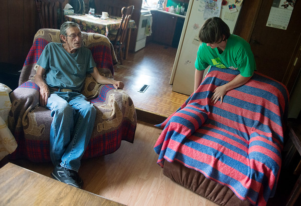 Globe/Roger Nomer<br /> Ashley Gooch talks with Henry Owens on Tuesday as she helps around the house in Galena.