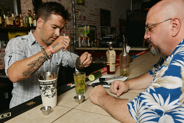 Globe/Roger Nomer<br /> Daniel Valentine helps customer John Oberley with a mint julep at Palace Pizza on July 1, 2014.