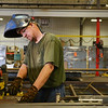 Globe/Roger Nomer<br /> Doug Whitehead fabricates a staircase at Atkinson Industries in Pittsburg on Wednesday morning.