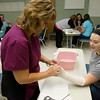 Globe/Roger Nomer<br /> Valerie Russow, staff educator for ER nurses at Freeman Health Systems, demonstrates a splint technique for Courtney Phillips on Wednesday during Health Academy at Freeman East.