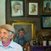 Globe/Roger Nomer<br /> Lowell Davis welcomes visitors to his studio at Red Oak II on Friday, July 11, 2014. The studio features much of Davis' work, including the self portraits seen behind him.