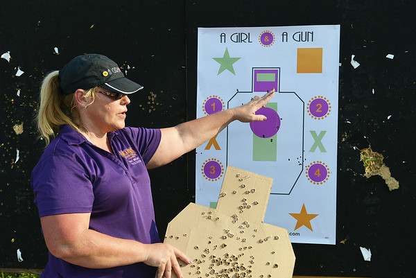 Globe/Roger Nomer<br /> Mary Bryant talks about a target during A Girl and a Gun shooting club on Tuesday evening.