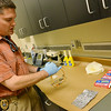 Globe/Roger Nomer<br /> Pittsburg Police Lt. Ben Henderson talks about the different tools used to make meth, including pseudoephedrine, during an interview at the Pittsburg Police Department on Monday.