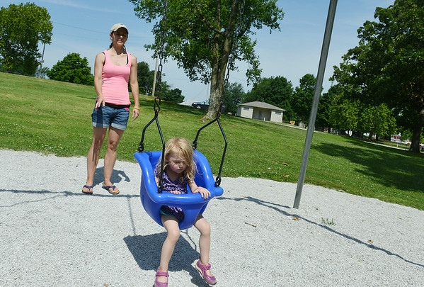 Globe/Roger Nomer<br /> Kelsey Baucom, Carthage, pushes her daughter Charlie, 2, during an outing at Municipal Park in Carthage on Monday morning.