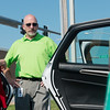 Globe/Roger Nomer<br /> Jennifer Reeves talks with Mike Hayward, business and community development manager for Empire, on Wednesday about an electric car shown at Missouri Southern.