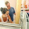 Jim Feeney, of Seekonk, Mass. and his daughter, Kayla Sylvia, of East Providence R.I., work to install drywall in a utility room inside a Rebuild Joplin house at 1725 Kentucky Ave. on Thursday.<br /> Globe | Laurie Sisk